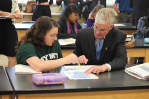 Superintendent Torlakson reviews the model with Taylor Piatt, a student in Lisa Hegdahl's 8th grade science class.
